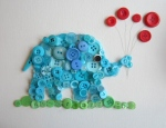 Button elephant with red balloons.